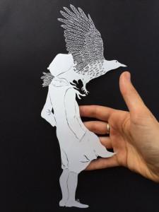 Папер арт. Человек и птица вырезанные из бумаги